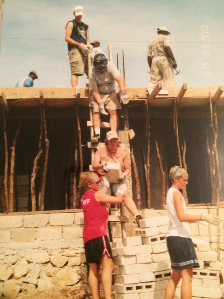 Passing blocks up to a roof we were about to pour at AFCA village.